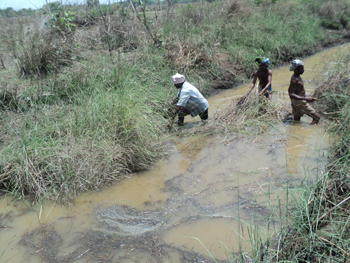 Desilting and cleaning of irrigation channel