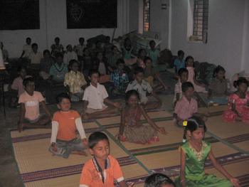 Students of Arivumaiyam practicing yoga