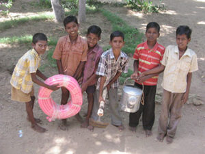 Students of Kandamangalam School with provided implements.